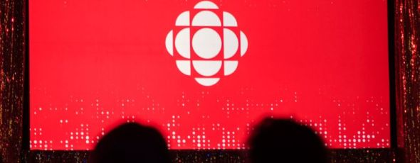 The CBC logo is projected onto a screen during the CBC's annual upfront presentation Financial Post | James Alexander Michie