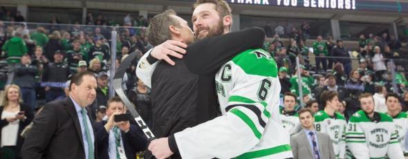 UND captain Colton Poolman hugs his dad, hockey athletic trainer Mark Poolman Grand Forks Herald   James Alexander Michie