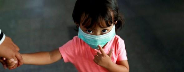 Coronavirus Girl wears mask National Review   James Alexander Michie