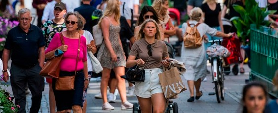People walk in Stockholm Getty Images Reuters National Post | James Alexander Michie
