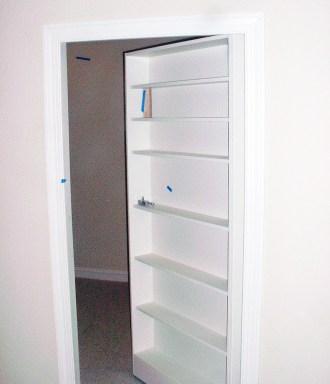 Secret Bookcase | Custom Builder Milwaukee | James Allen Builders