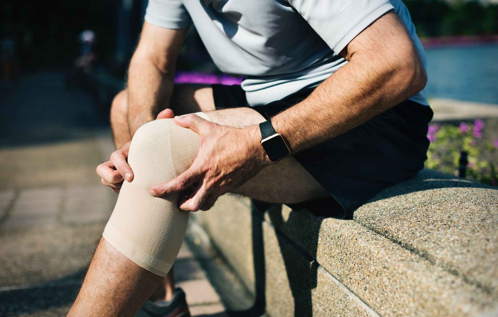 A man covering his left knee
