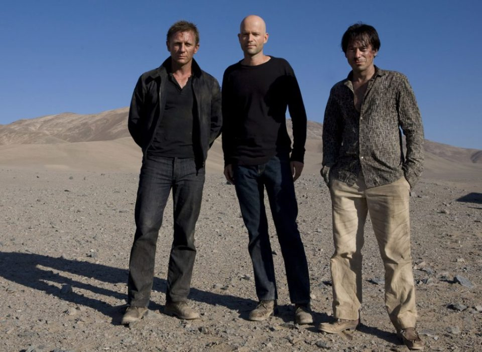 Daniel Craig, Marc Forster, and Mathieu Amalric on location in Chile.  Photo by Karen Ballard
