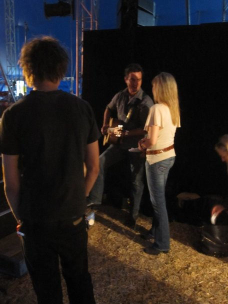 Luke Austen and Felicity Urquhart share a backstage moment during Saturday Night Country live show.