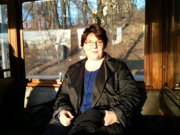 Sue on the old tram in Stockholm