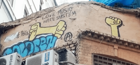 Yellow Fists off Istikal Street in Istanbul Love Music Hate System