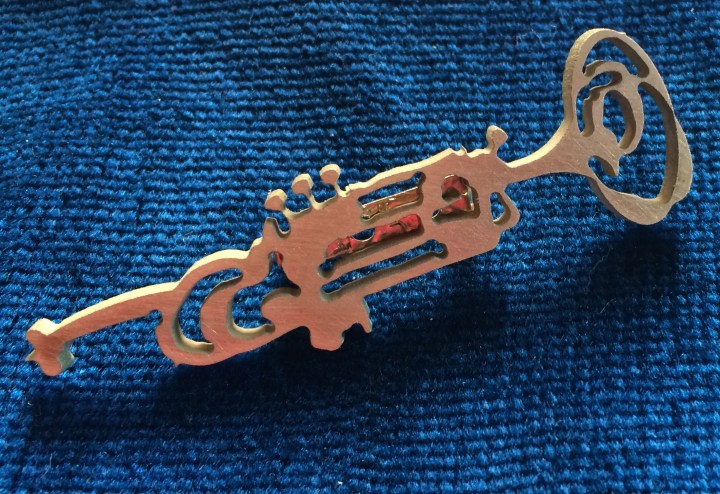 trumpet brass on blue