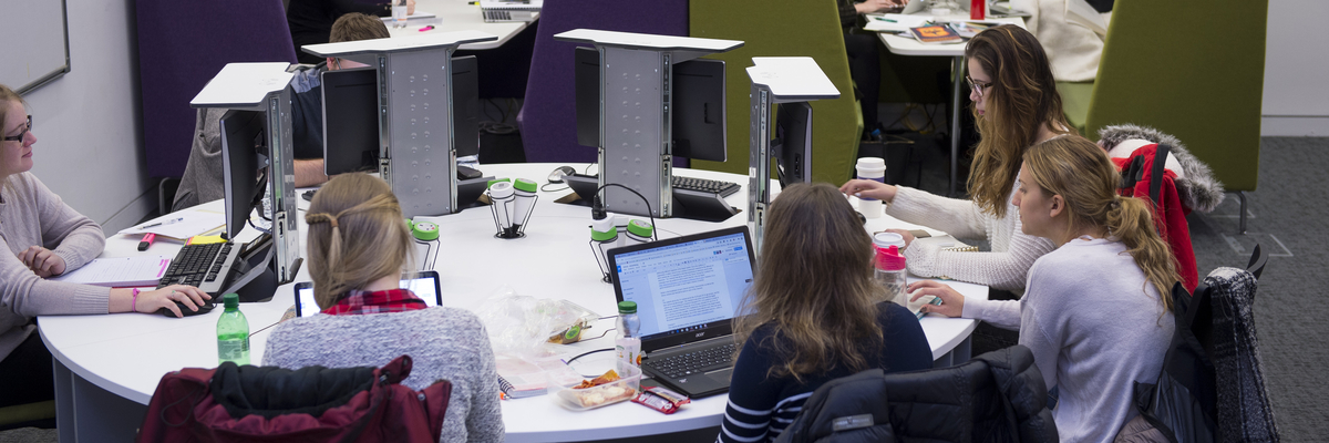 Women using computers in the JKCC at Edinburgh Napier