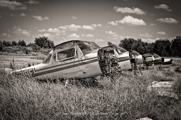 Day 5 of the 5 Day Black and White Photo Challenge: Grounded–Abandoned Prop Planes