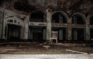 Seating for One in the Grand Lobby - The Abandoned Baker Hotel in Mineral Wells, Texas