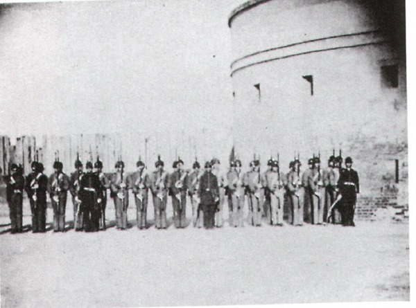 "The Charleston Zuave Cadets in Castle Pinckney {note: Francis Miller's 1911 ""Photographic History of the Civil War"" Vol 1 ""The Opening Battles"" identifies the 4 officers in front left to right are Captain C.E.Chichester; Lt. E. John White; Lt. B.M. Walpole; Lt. R.C.Gilchrist."