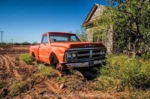 Abandoned Farm House and GMC Truck sitting on Blocks