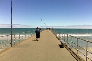 Sue walks on the pier at Glenelg