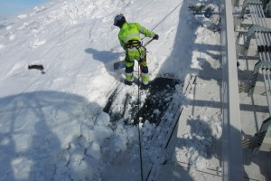 Ice and snow being removed from Globen