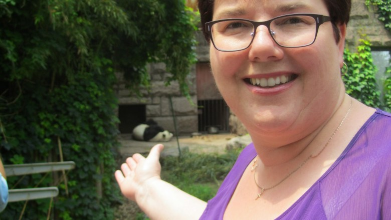 Sue points to a sleeping panda at Beijing Zoo