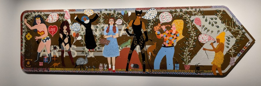 Kaylene WHISKEY Yankunytjatjara language Indulkana, SA ​ Seven Sistas 2018 water-based enamel on SA tourist attraction road sign 75 x 270 cm