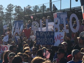 Rubio supporters display their excitement for his visit by waving hand made signs behind him throughout his entire speech. Photo by Mikayla Grumiaux