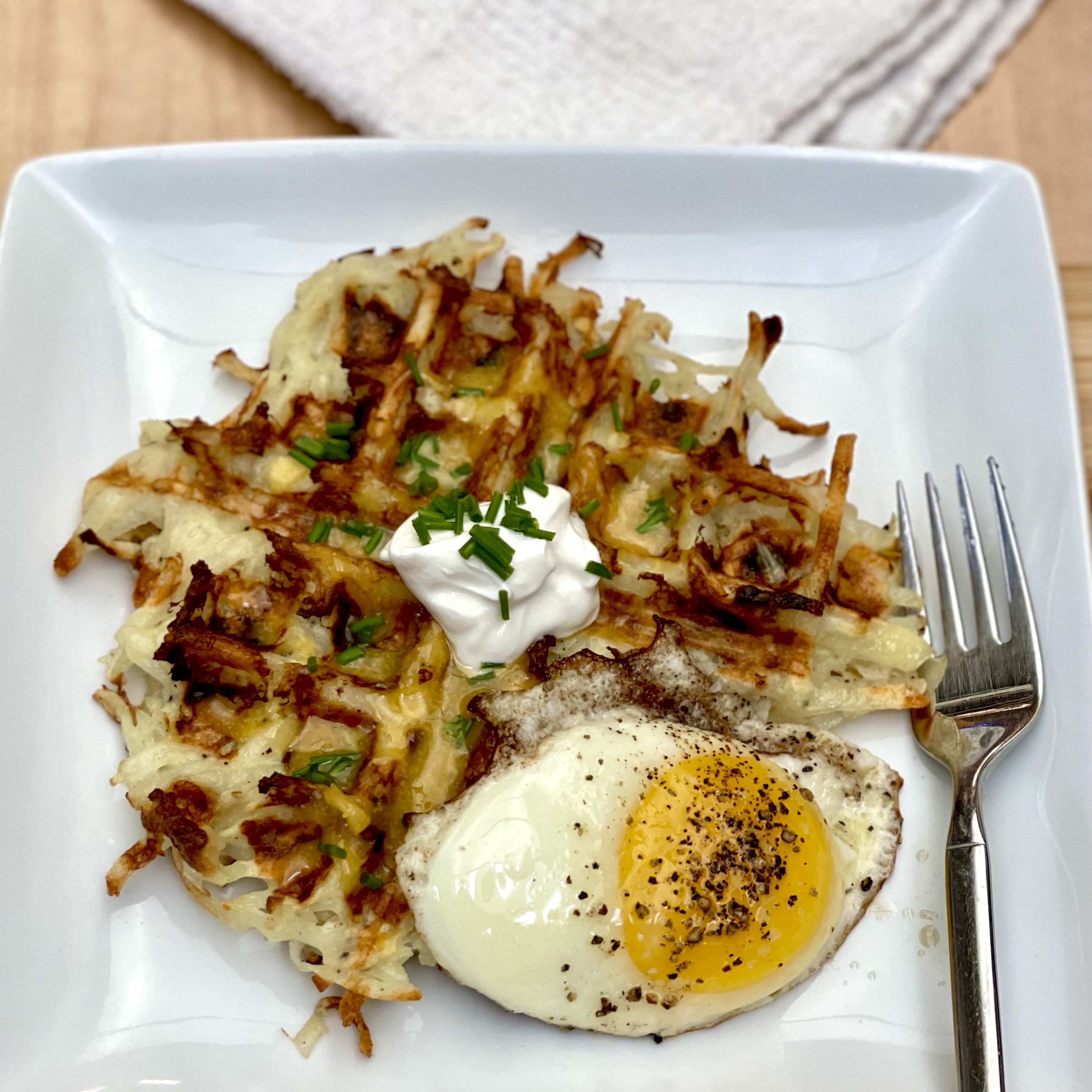 In a mixing bowl, combine shredded potato, salt, and pepper. Waffle Maker Hash Browns Skipandloretta Photography Food Fun Travel