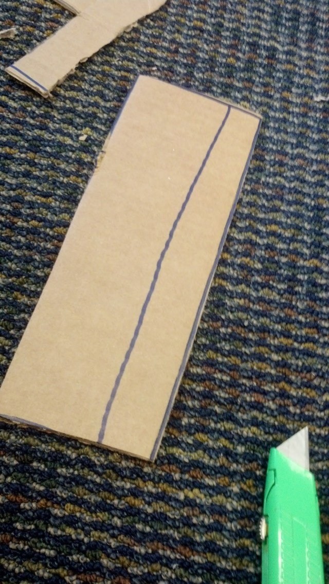 Cardboard and the right teacher's tool for the job.