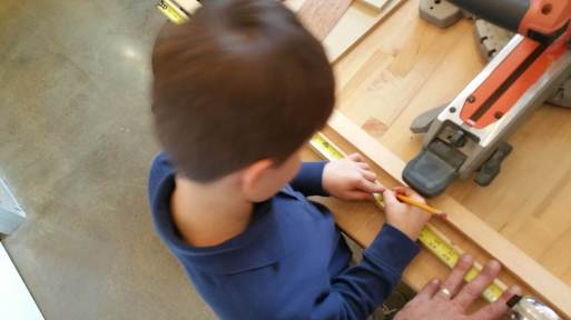 Measuring and marking out the lengths of the legs for the easel stand.