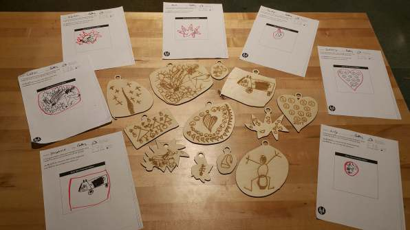 A collection of Kindergarteners' hand-drawn laser cut ornaments.