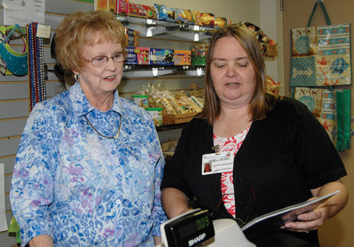 Courtesy photo. Janell Sluga (right), Geriatric Care Manager Certified with Senior Life Matters stops by the Lutheran Gift Shop to visit with Ginnie Sloan (left),  a volunteer and retired Director of Activities, to answer questions she has about long term care insurance.