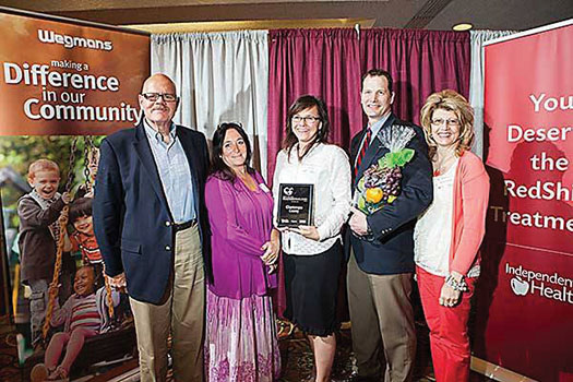 Courtesy photo. From left: Hugh Tranum of Crown Benefits and April Reynolds, Kitty Crow, Chuck Holder, and Brenda Johnson of Chautauqua County.