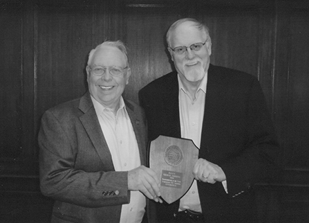 Mr. George Jarrell (left) is presented the 2014 Barbershopper of the Year Award by Gary Larson, the 2013 award recipient.