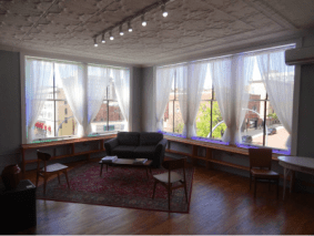 The deadline for submissions to the third biennial juried Women Create art exhibit is January 31, 2016. The exhibit will be next spring at the Dykeman-Young Gallery and Vintage Emporium in downtown Jamestown, New York. The lounge area of the gallery is pictured here.