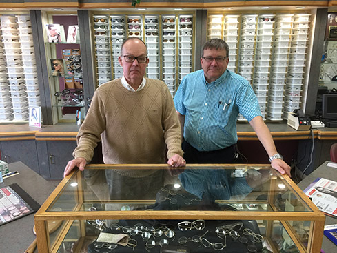 "Hall and Laury Opticians owners (L to R): Arthur ""Ted"" Laury and Gary Nelson."