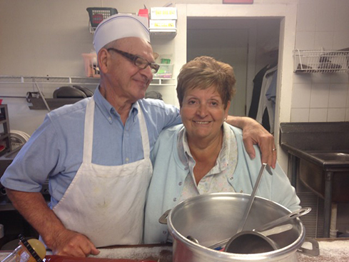 "Augusto ""Gust"" and Dianne Calamunci serve up the ""Hots"" at Johnny's Lunch."