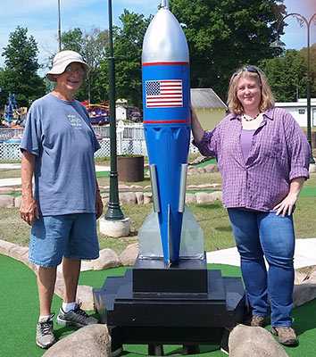 Volunteer Chuck Ludwig and Park Manager Marla Bingham-Connelly with the original course rocket on site for more than 60 years.