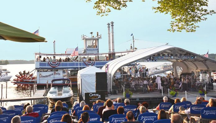 Audience enjoying concerts on the floating stage.