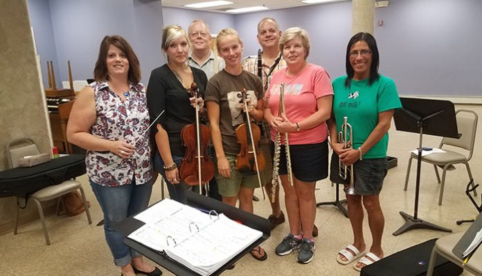 The Jekyll & Hyde pit orchestra. (L to R) Michelle Battaglia, pit orchestra conductor; Meghan Shay (viola); Basil Getz  (percussion); Sadie Anderson (violin); John Cross  (clarinet and saxophone); Amy Cross (flute); Lisa Rodriguez  (trumpet). (Not shown) Tim Przybelinski; Amanda Andrews (cello), Nancy Larson (French horn); Curtis Barnes (c larinet and saxophone); Peter Cohen (bass); Jenny Cross (flute); Mateo Mendez (oboe).