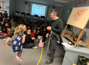 Love Elementary School UPK student, Riley Shane, reacts to meeting children's book author and illustrator, Bob Shea. Riley, along with her classmates, won the opportunity for a visit from Mr. Shea thanks to Erie 2 Chautauqua-Cattaraugus BOCES and the School Library System.