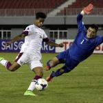 141010 NAY PYI TAW Oct 10 2014 Akram Hassan A Y Afif L of Qatar shoots the ball during
