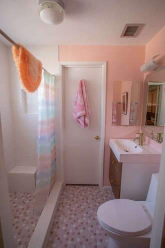 Pink midcentury bathroom on a budget