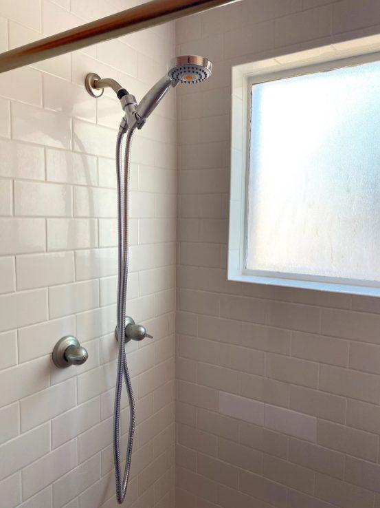 Vintage Crane shower fixture with subway tile