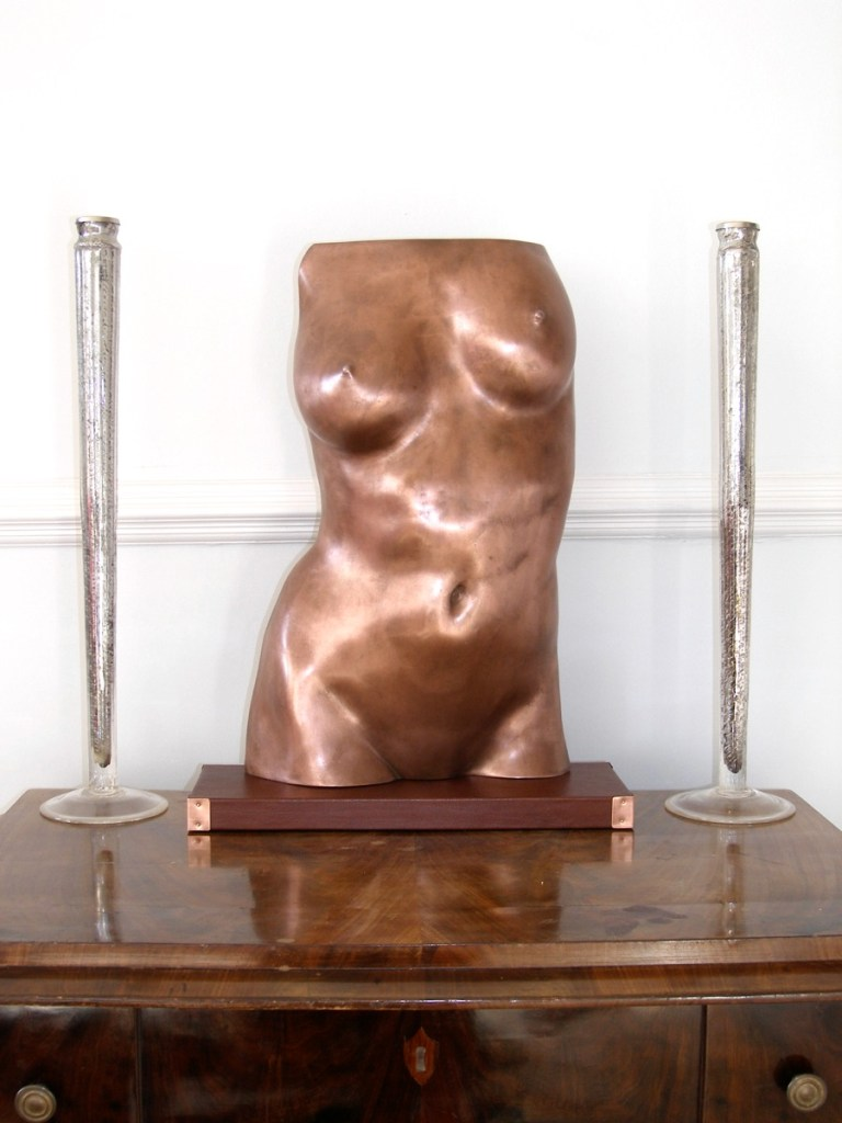 Sculpture of a female torso in cold cast copper
