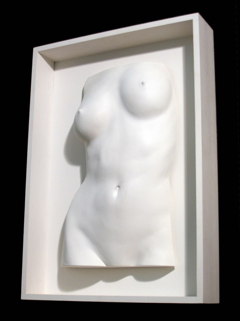 Framed female torso sculpture in plaster