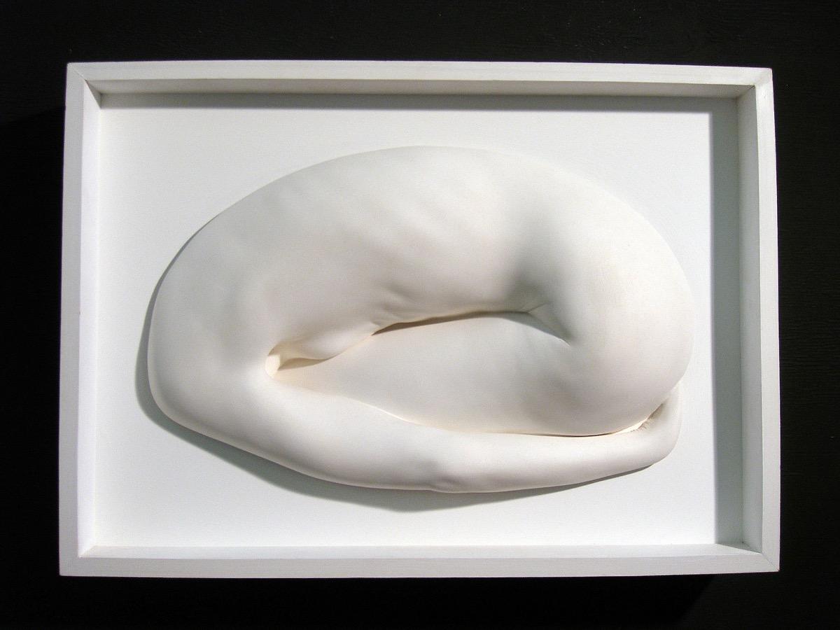 Framed plaster cast yoga sculpture in the balasana pose