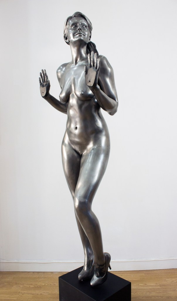 A nude lifecast sculpture of glamour model and porn actress Natasha Marley in fibreglass