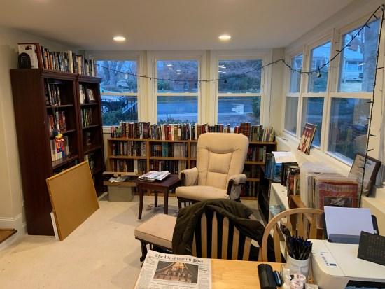 The other side of my office, surrounded by books.