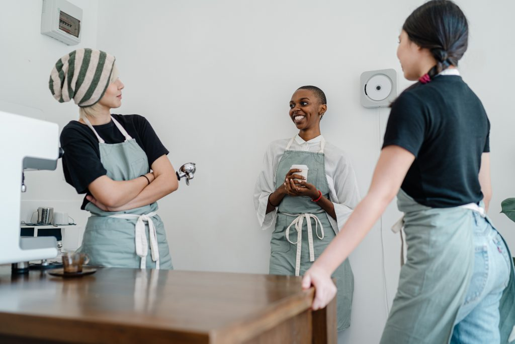 Women at work in a kitchen, enjoying each other's company.