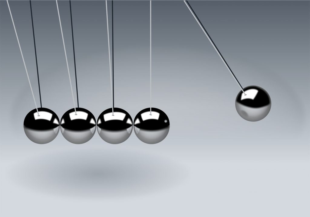 Picture of a Newton's cradle, symbolising momentum, when it comes to setting goals
