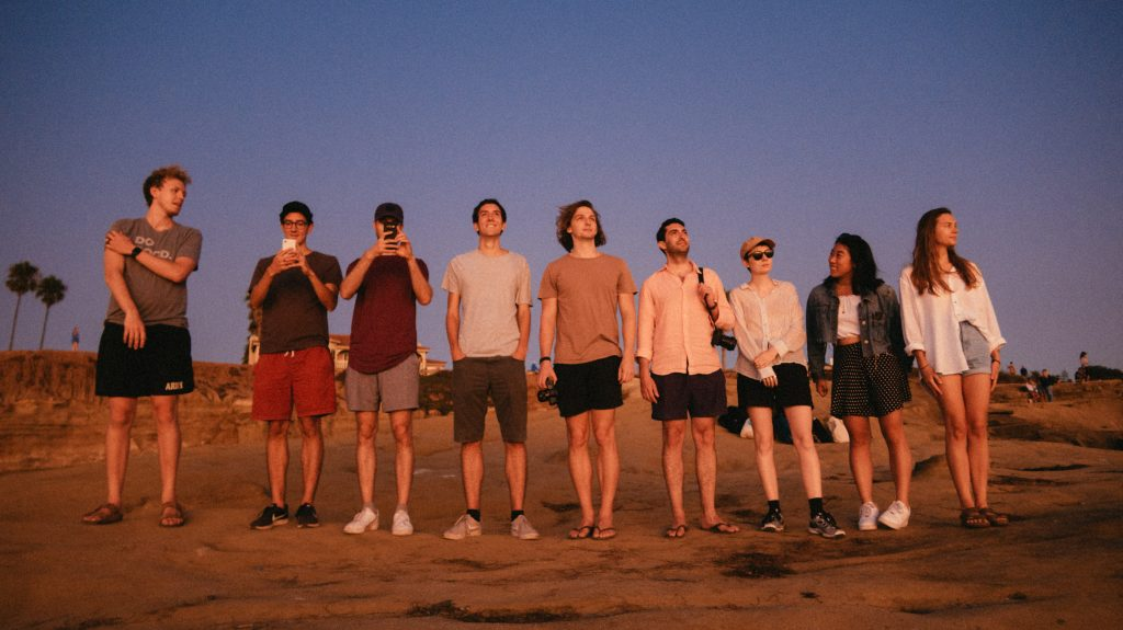picture of people on a beach - signifying teams and businesses coming together