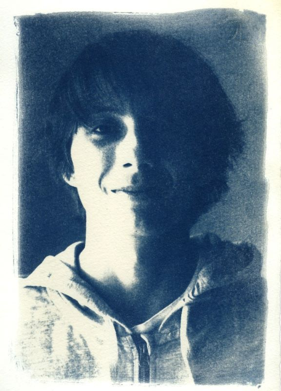 beautiful boy portrait print with the ancient technique of cyanotype