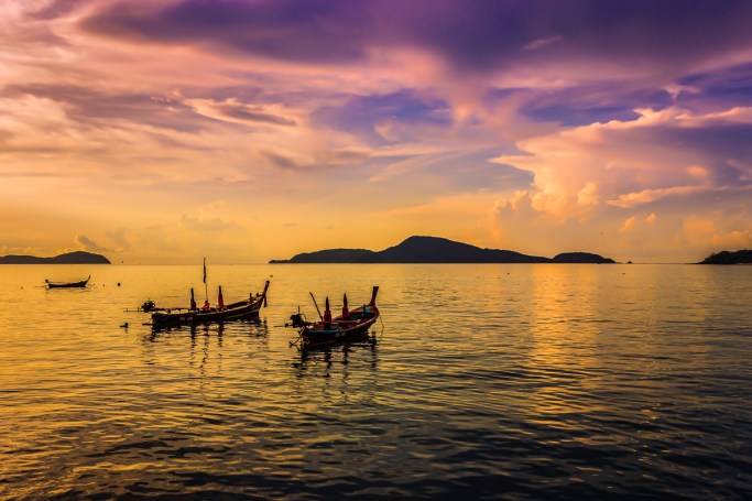 Islands off the coast of Phuket silhouetted in the beautiful morning light