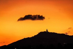 Big Bhudda watches a cloud drift by as the sun sets just before Sonkhran Festival