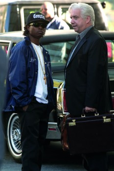 (L to R) Eazy-E (JASON MITCHELL) speaks with N.W.A manager Jerry Heller (PAUL GIAMATTI) in Straight Outta Compton. Credit: Jaimie Trueblood